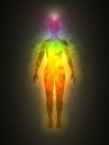 Illustration of human (woman) energy body silhouette with aura and chakras. Theme of Creation, healing energy, connection between the body and soul.