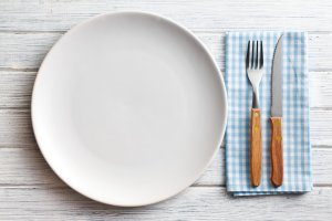 the white plate with fork and knife